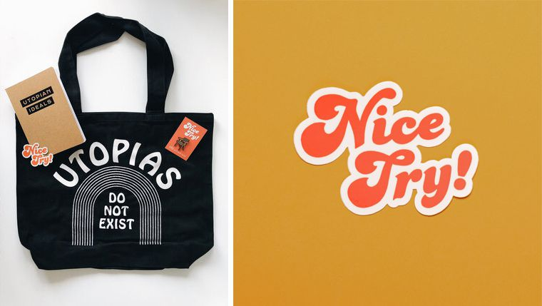 A selection of merchandise, including a black tote bag, a small sticker, a chair pin, and a small brown notebook.