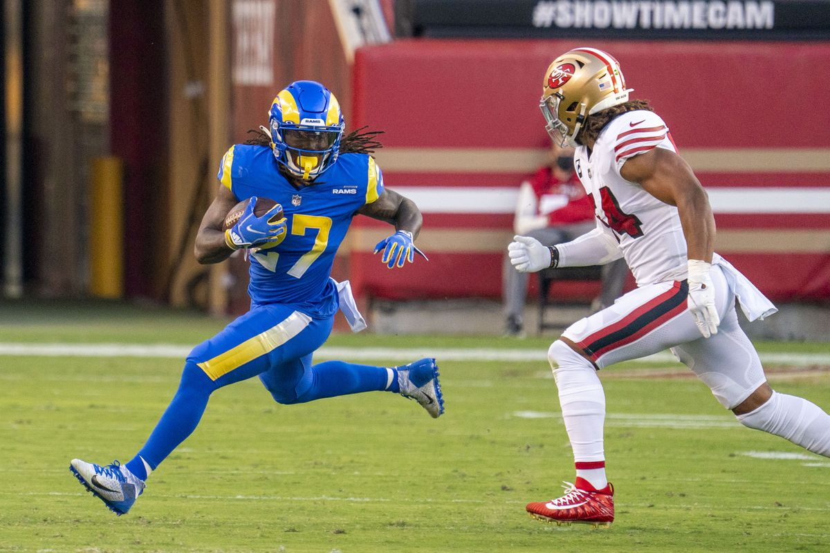 Los Angeles Rams running back Darrell Henderson (27) runs against San Francisco 49ers middle linebacker Fred Warner (54) during the first quarter at Levi's Stadium.