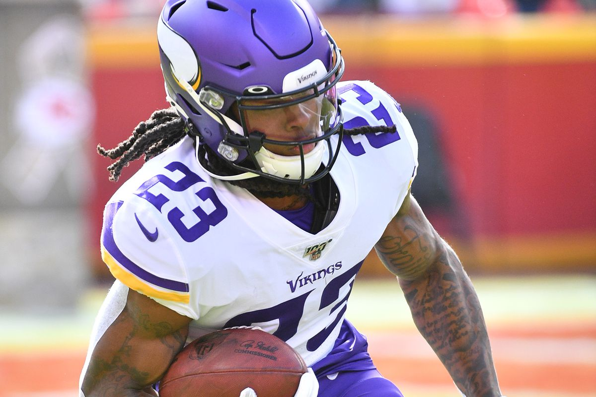 Minnesota Vikings running back Mike Boone warms up before the game against the Kansas City Chiefs at Arrowhead Stadium.