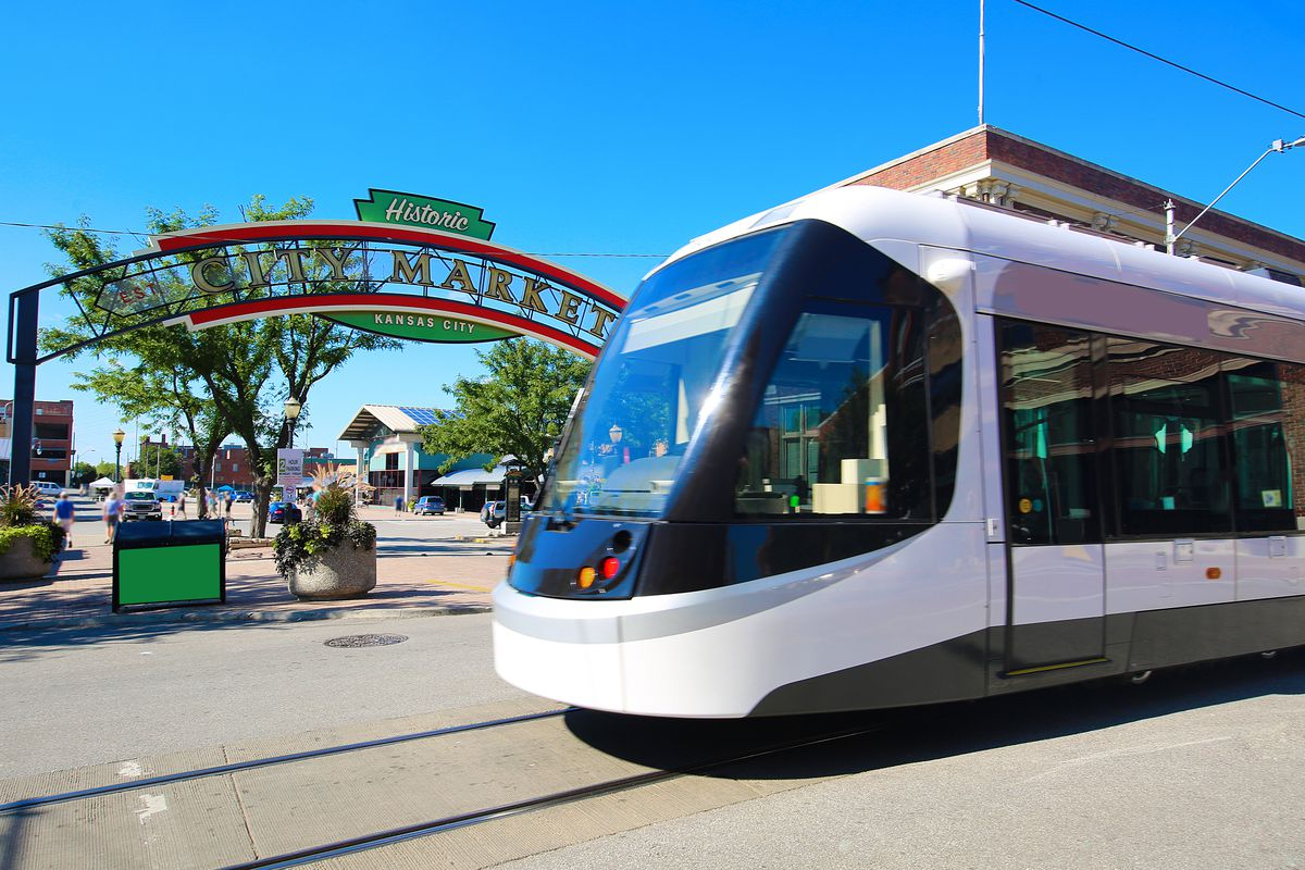 Kansas City's downtown streetcar passes by the Historic River Market.