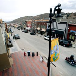 A motorcyclist ride along Main Street in Park City on Monday, April 27, 2020. Some businesses are open but many remain closeddue to the spread of COVID-19.