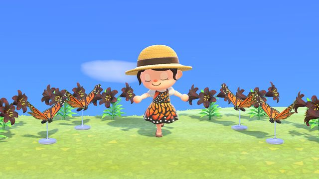 Animal Crossing: New Horizons A character poses, wearing a custom dress made from a monarch butterfly style