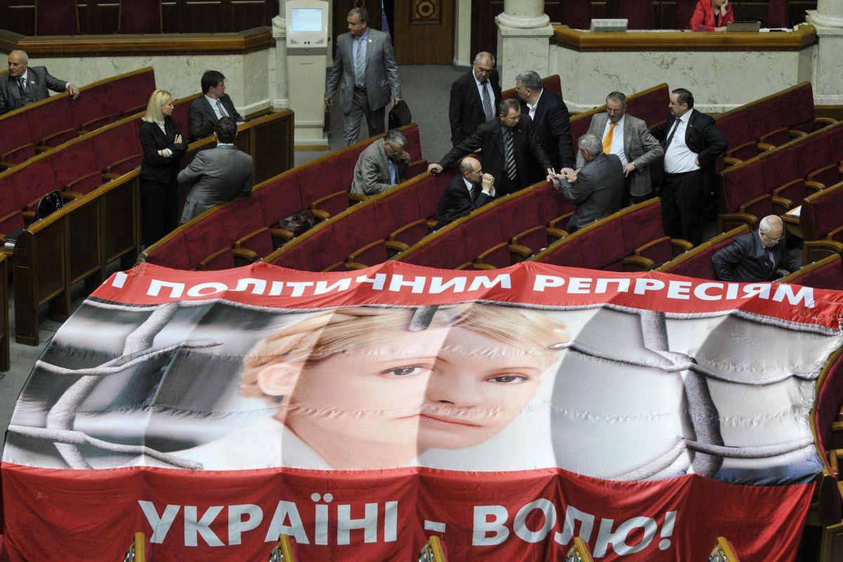A banner placed on seats usually occupied by opposition lawmakers is used to protest against the arrest of Ukraine's former Prime Minister Yulia Tymoshenko, during a session in Kiev, Ukraine, Wednesday, April 25, 2012. Former Ukrainian Prime Minister Yuli