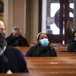 Congregants pray after receiving the imposition of ashes from Father Tom Hurley at Old St. Patrick's Catholic Church on the Near West Side on Ash Wednesday, Feb. 17, 2021.