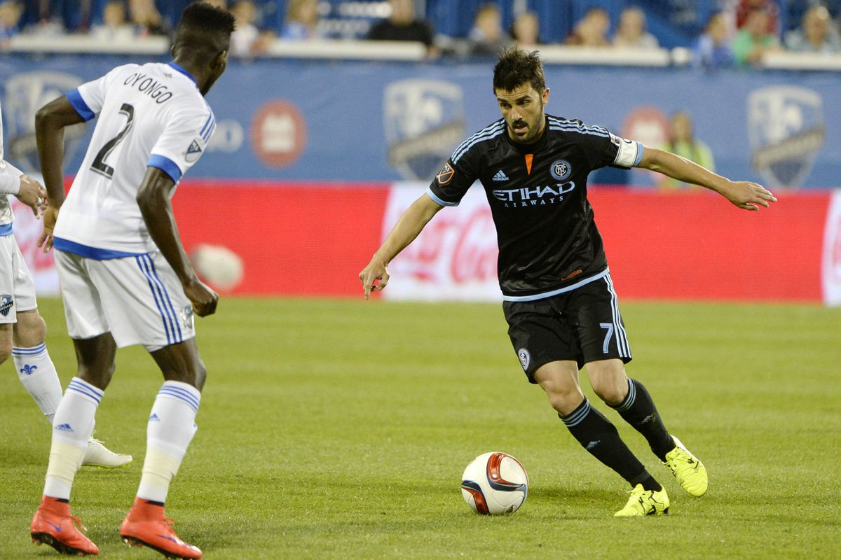 David Villa takes on IMFC defender Ambroise Oyongo in the box.