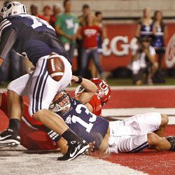 Brigham Young Cougars quarterback Riley Nelson (13) looses the ball at the goal line which would have been a touchback except for a facemask call by Utah in the end zone during the first half as the University of Utah and BYU play football Saturday, Sept. 15, 2012, in Salt Lake City, Utah.