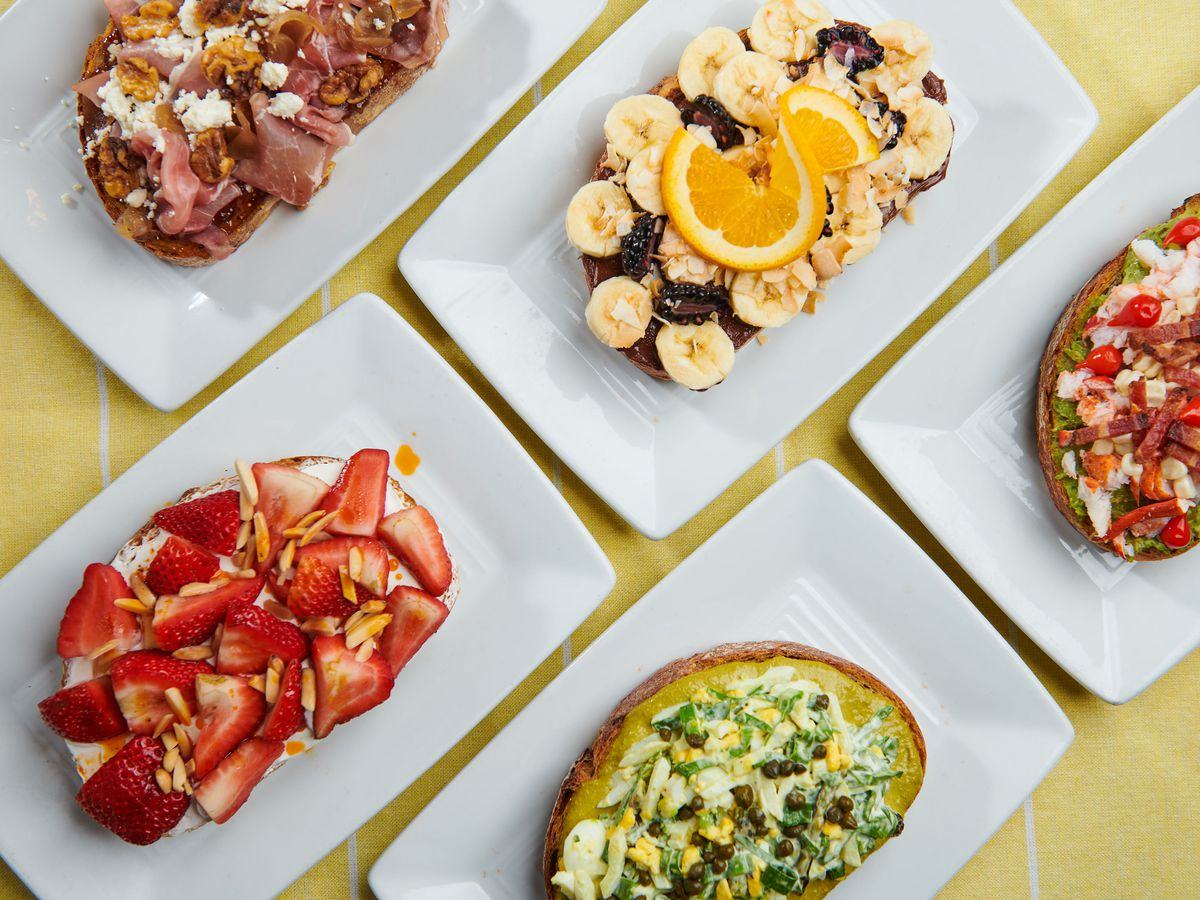 Overhead view of toasts topped with various ingredients
