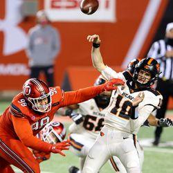 Utah Utes defensive tackle Viane Moala (98) disrupts a pass attempt by Oregon State Beavers quarterback Chance Nolan (10) as Utah and Oregon State play a college football game at Rice Eccles stadium in Salt Lake City on Sunday, Dec. 6, 2020. Utah won 30-24.