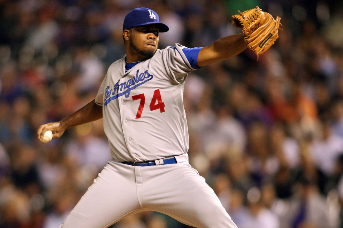 May 1, 2012; Denver, CO, USA; Los Angeles Dodgers pitcher Kenley Jansen (74) delivers a pitch during the eighth inning against the Colorado Rockies at Coors Field.  Mandatory Credit: Chris Humphreys-US PRESSWIRE