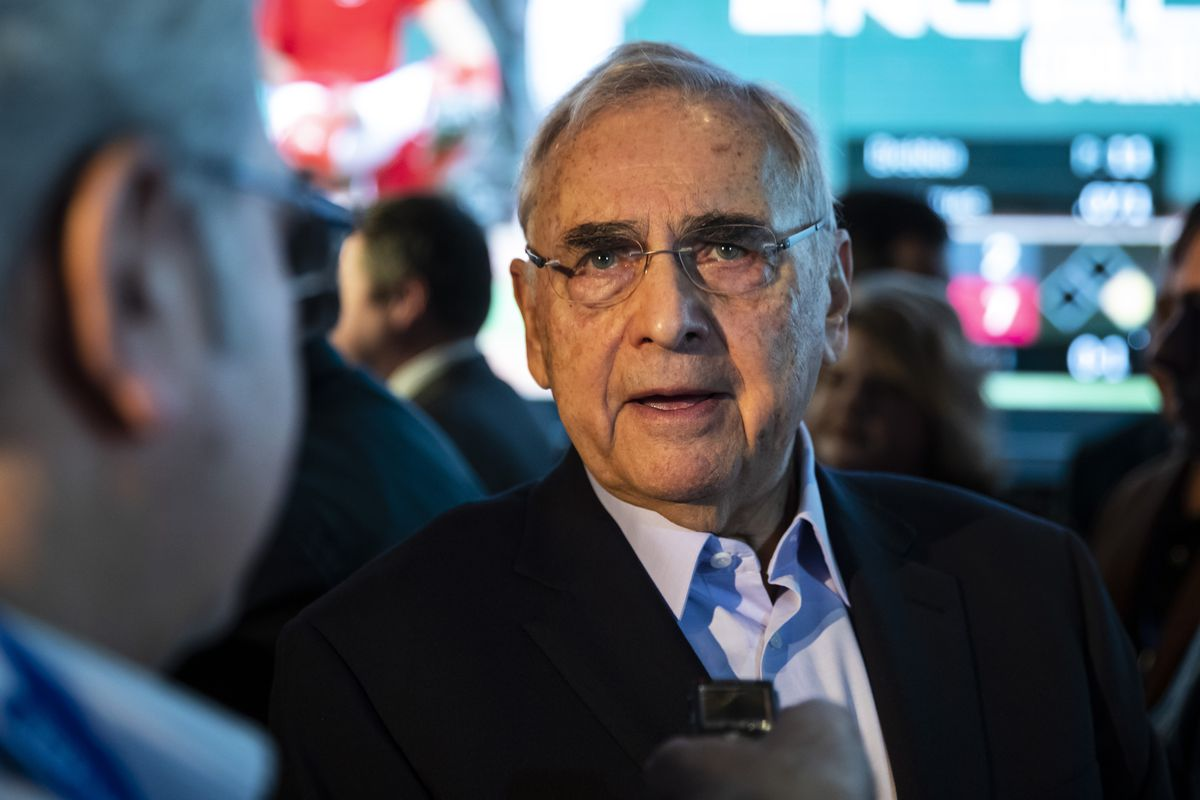 Neil Bluhm, chairman of Rivers Casino, talks with a reporter during the public opening of BetRivers Sportsbook at Rivers Casino in Des Plaines last year.