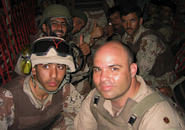 Daniel Ganoza, right, flying with Iraqi troops on a C-130 aircraft, during his Air Force career.