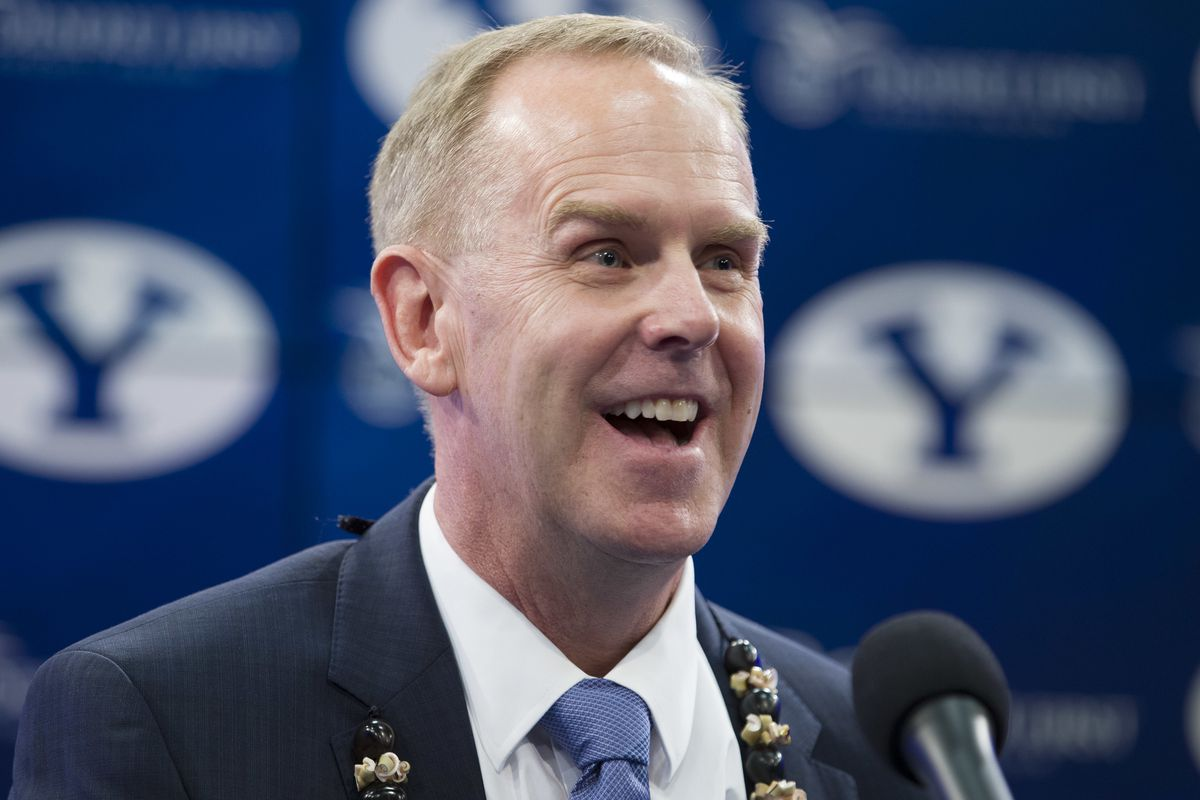 BYU's director of athletics Tom Holmoe introduces Kalani Sitake as the new head football coach at a press conference in Provo Monday, Dec. 21, 2015.