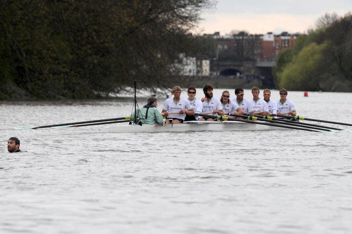 The Boat Race is halted as a swimmer interrupts the 158th Boat Race on the river Thames, London, Saturday April 7, 2012. Cambridge won a dramatic Boat Race against Oxford on Saturday following a 31-minute mid-race postponement after a man jumped into the