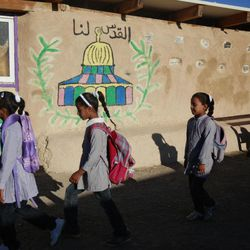 Palestinian Bedouin Students arrive to school at Khan al-Ahmar, near the west bank city of Jericho, Sunday, Sept 2. 2012. Dozens of Palestinian children in the ramshackle Bedouin community outside Jerusalem defy Israeli authorities with a simple act: going to school for the beginning of the scholastic year. Their school is a series of buildings made of mud and old tires that were built over the objections of Israeli authorities who are now threatening to demolish the structures. Israeli authorities say the community is willfully building illegally.
