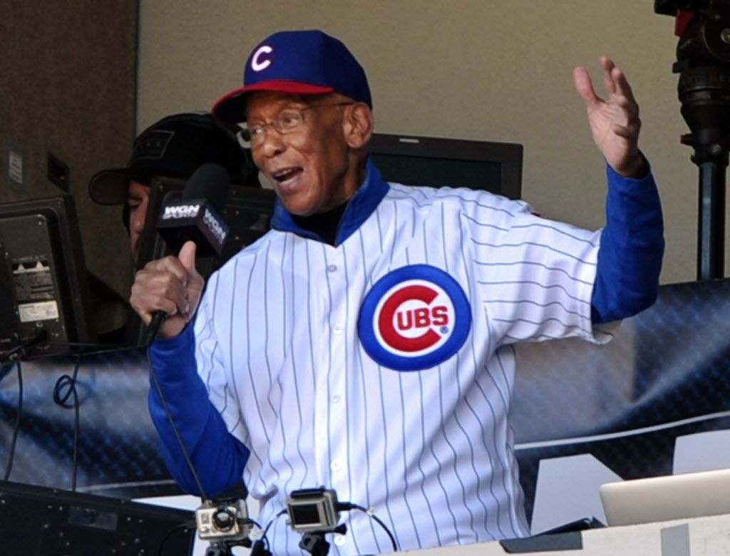 Ernie Banks leads the crowd during the seventh inning stretch at Wrigley Field in 2013.