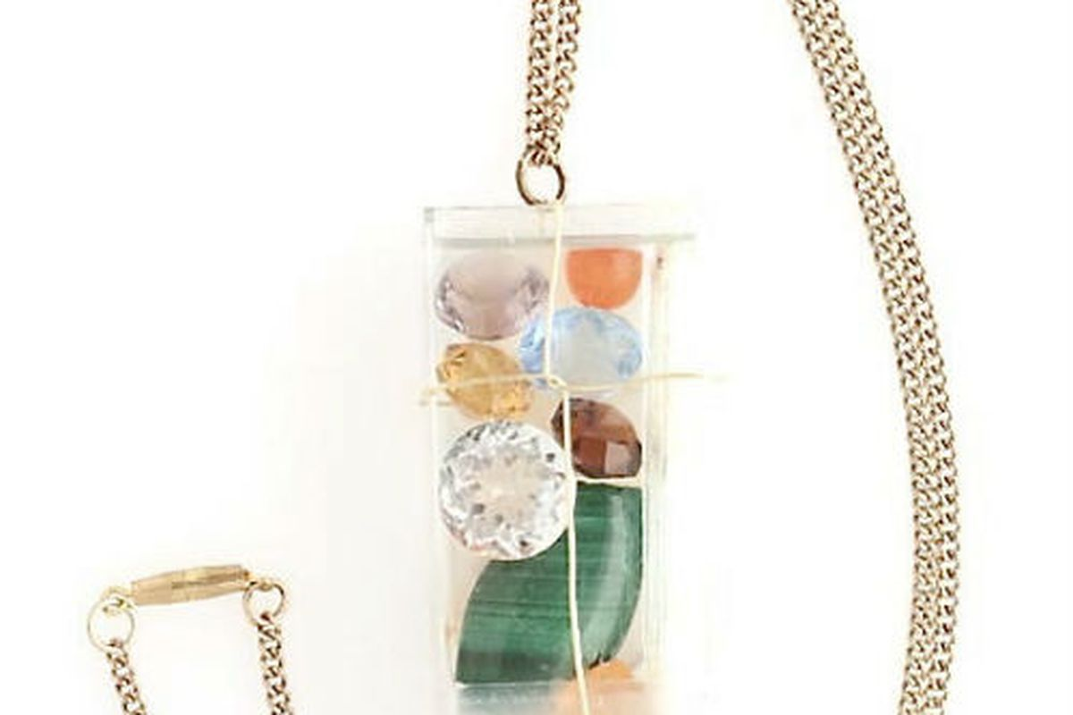 """Laurie Pike's Hexagon Accessories. Photo via <a href=""""http://www.etsy.com/listing/95936681/pendant-of-clear-container-with-10-semi?ref=v1_other_2"""">Etsy</a>."""