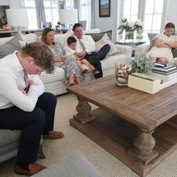 Thomas and Mandi Godfrey and their family listen to the opening prayer as they watch the morning session of the 191st Annual General Conference of The Church of Jesus Christ of Latter-day Saints from their home in Holladay on Saturday, April 3, 2021.