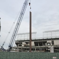 Beam being lowered on the Clark Street side of the triangle lot