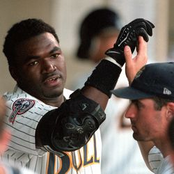 Teammates high five Buzz hitter David Ortiz after his home run during game against Vancouver, 06.22.99.