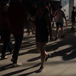 Fans walk around Audi Field before the game began