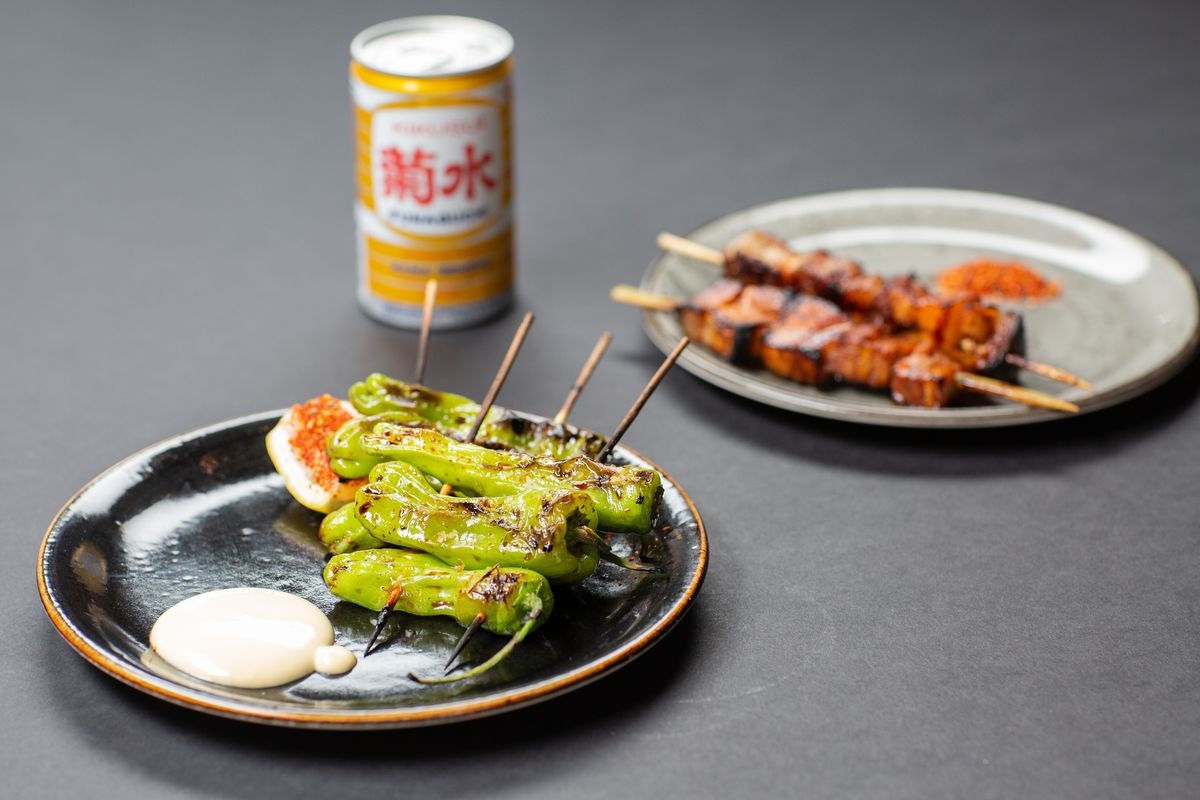 Shishito peppers, Japanese beer, and pork belly skewers from Shibuya Eatery
