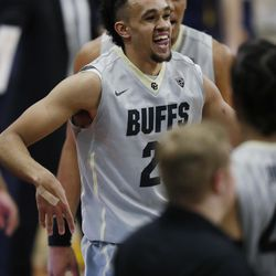 Colorado Buffaloes guard Derrick White jokes with teammates after hitting a key, three-point basket against California late in the second half of an NCAA basketball game Saturday, March 4, 2017, in Boulder, Colo. Colorado won 54-46. (AP Photo/David Zalubowski)