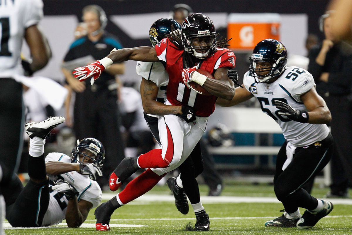 ATLANTA, GA - DECEMBER 15:  Julio Jones #11 of the Atlanta Falcons runs for yards after the catch against the Jacksonville Jaguars at the Georgia Dome on December 15, 2011 in Atlanta, Georgia.  (Photo by Kevin C. Cox/Getty Images)