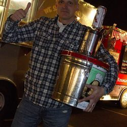 Rene Lenger with his pony keg of PBR trophy.