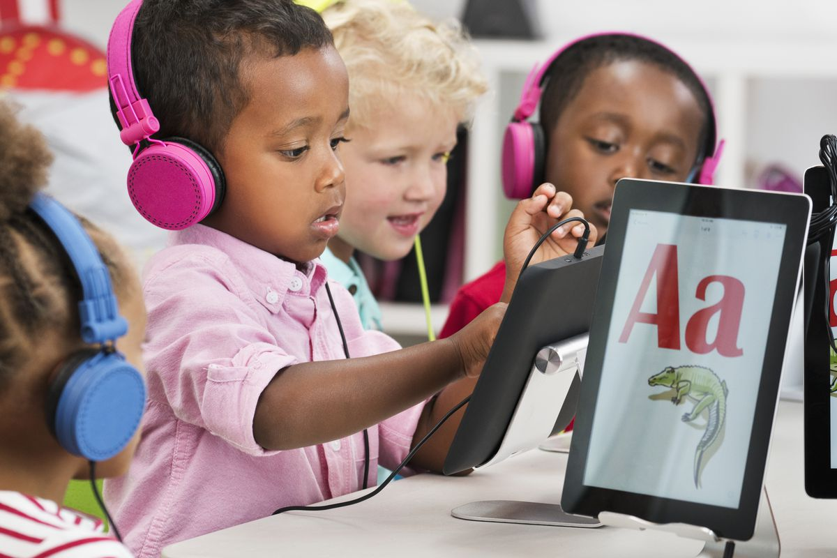 Students learning alphabet with digital tablets (Ariel Skelley   Getty Images)