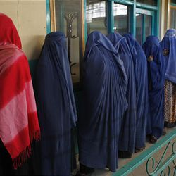Afghan women voters line up to cast their ballots at a polling station in a mosque in Kabul Thursday.