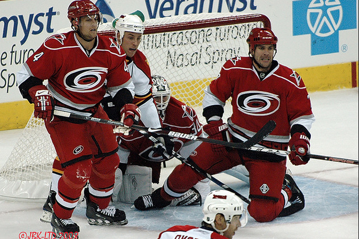 Nic Wallin and Dennis Seidenberg protect the net in front of Cam Ward in the 2008-09 season opener vs. Florida. Carolina came out on top, 6-4.