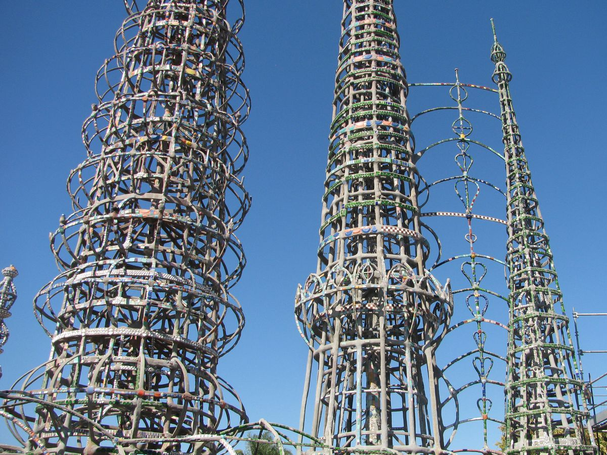 Three tall towering metal structures,