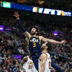 Utah Jazz guard Ricky Rubio (3) lays it up ahead of Cleveland Cavaliers guard Jose Calderon (81) at Vivint Arena in Salt Lake City on Saturday, Dec. 30, 2017.