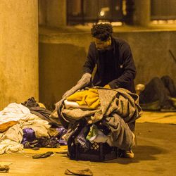 """A homeless man begins packing his belongings in lieu of the deadline that residents of """"The Triangle"""" were given to evacuate the area by the city of Chicago, Monday, June 11, 2018, in Chicago. 
