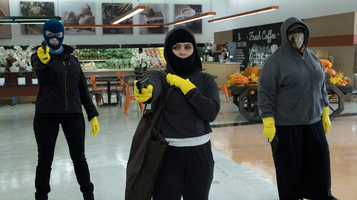 Christina Hendricks, Mae Whitman, and Retta in holding up a Michigan supermarket in Good Girls