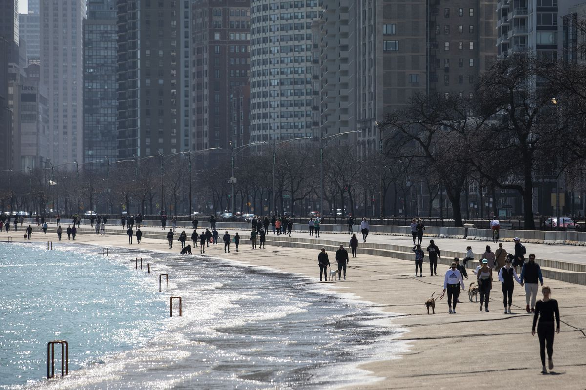 Hundreds could be seen enjoying warm weather on the Lakefront Trail near Oak Street Beach last month before Mayor Lori Lightfoot ordered the trail closed.