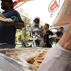 Food is served as homeless residents are treated to a picnic lunch in Salt Lake City on Sunday, Aug. 27, 2017. Participants also received a new blanket and listened to live music.