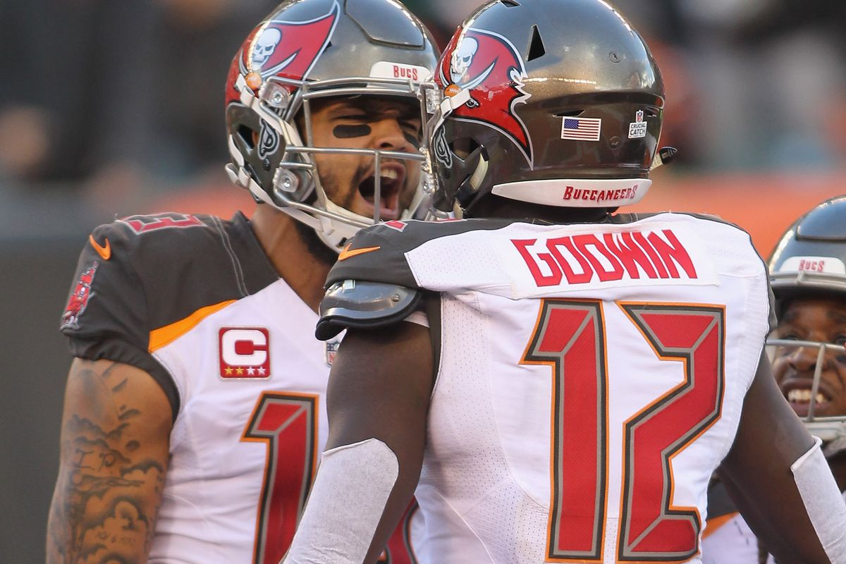 Mike Evans and Chris Godwin of the Tampa Bay Bucccaneers celebrate a touchdown during their game against the Cincinnati Bengals at Paul Brown Stadium on October 28, 2018 in Cincinnati, Ohio.