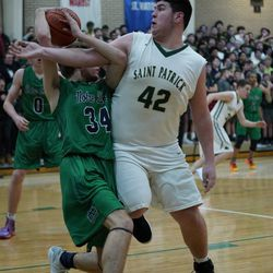 St, Patrick's Joseph Fanning (42) fouls Notre Dame's Tim Mundt (34), Friday 02-08-19. Worsom Robinson/For the Sun-Times.