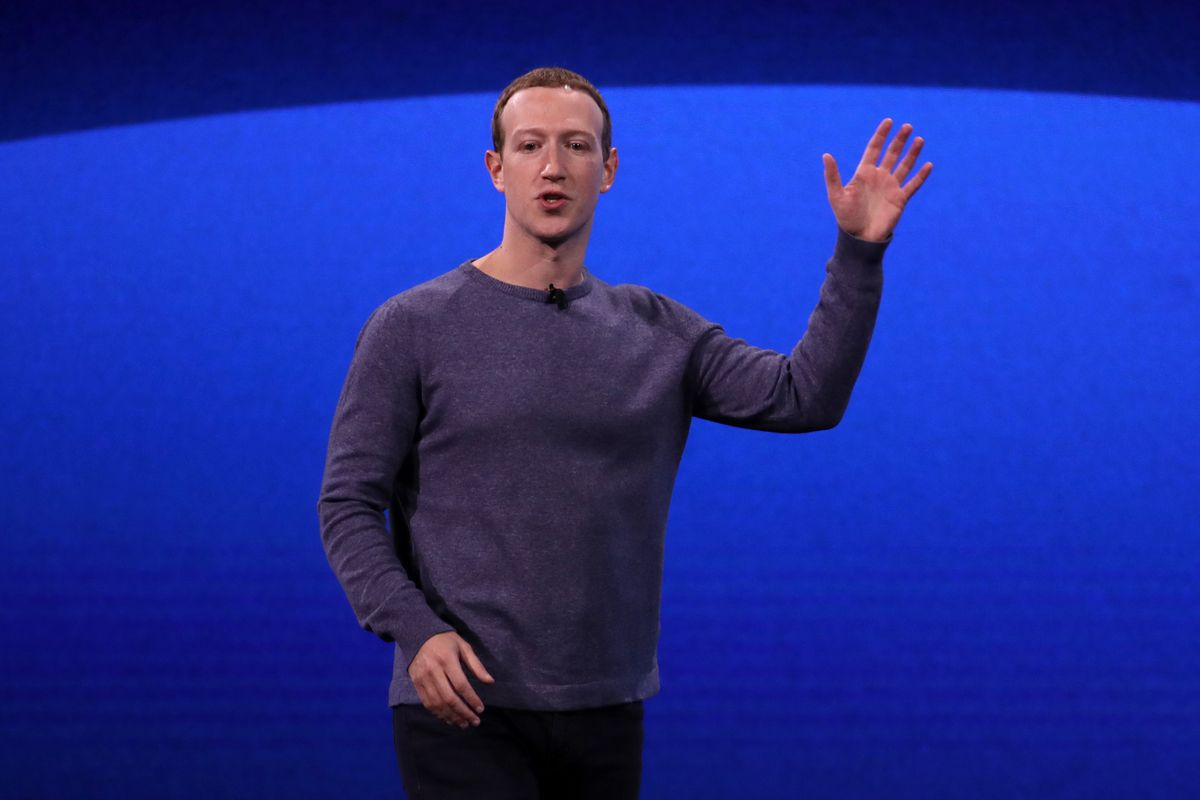 Facebook CEO mark Zuckerberg waves onstage at the annual F8 developer conference in San Jose