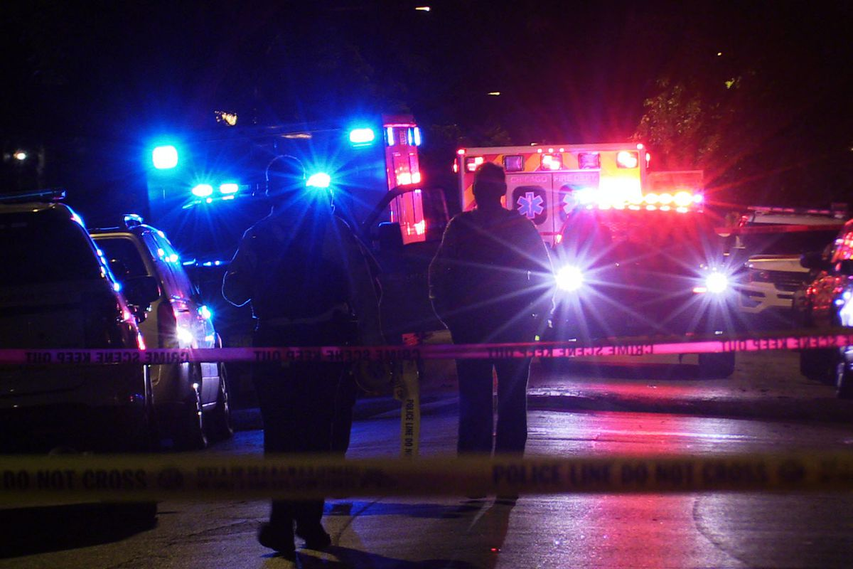 Chicago police investigate the scene where 2 people were shot in Austin Sept. 29, 2019.