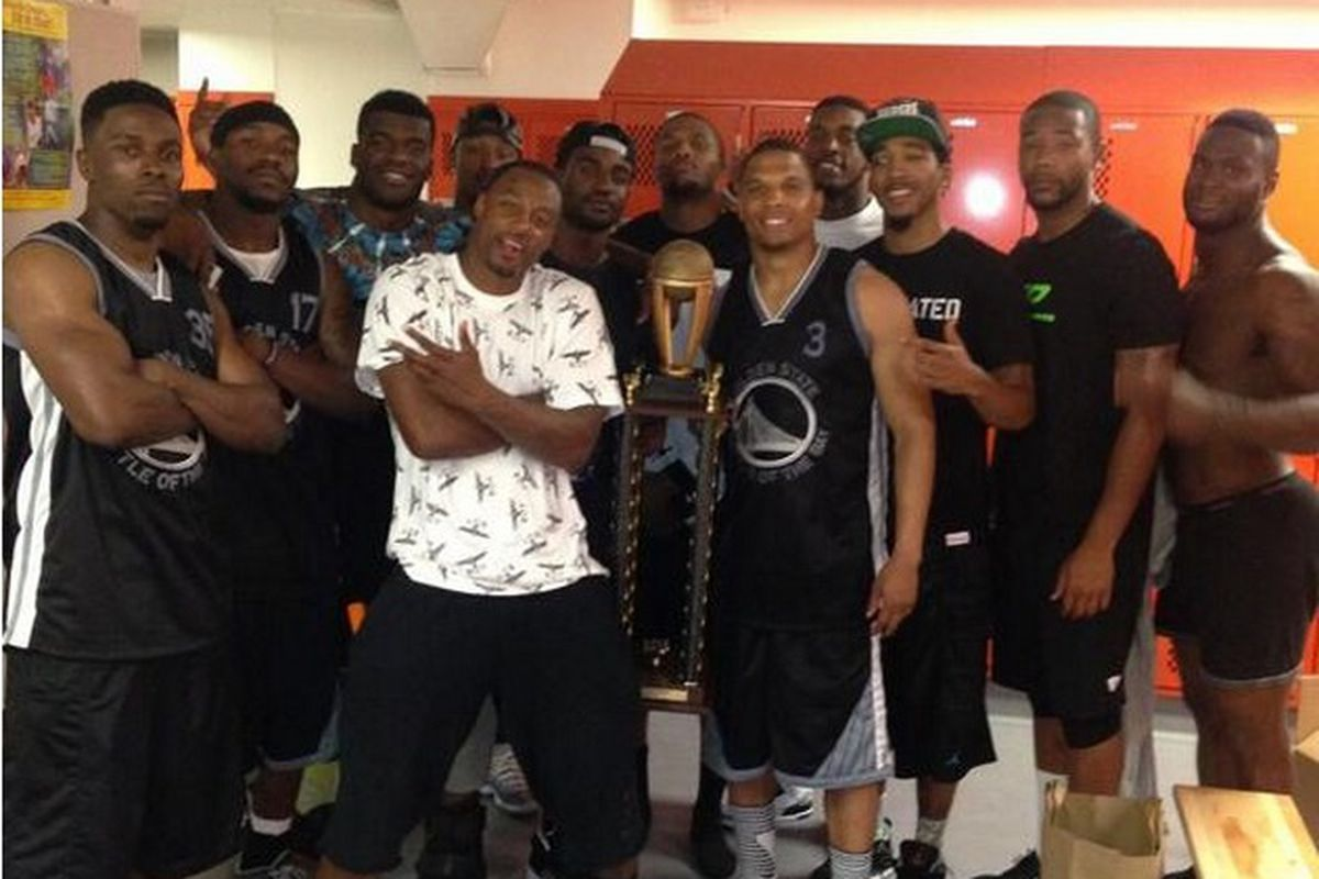 Raiders pose with their trophy after winning the first annual Battle of the Bay charity basketball game