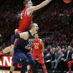 Utah Utes forward Jakob Poeltl (42) tries to get at the ball over Brigham Young Cougars forward Nate Austin (33) as Utah and BYU play in the Huntsman Center in Salt Lake City Wednesday, Dec. 2, 2015. Utah won 83-75.