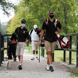 Mount Carmel's Michael Dobrich walks the course with teammates during practice at Jackson Park Golf Course.
