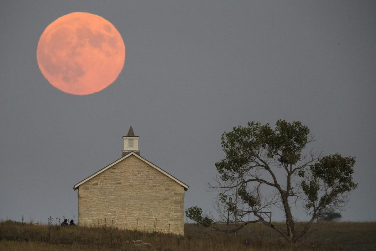 It was the first time Sunday since 1982 that a total lunar eclipse was combined with a supermoon.