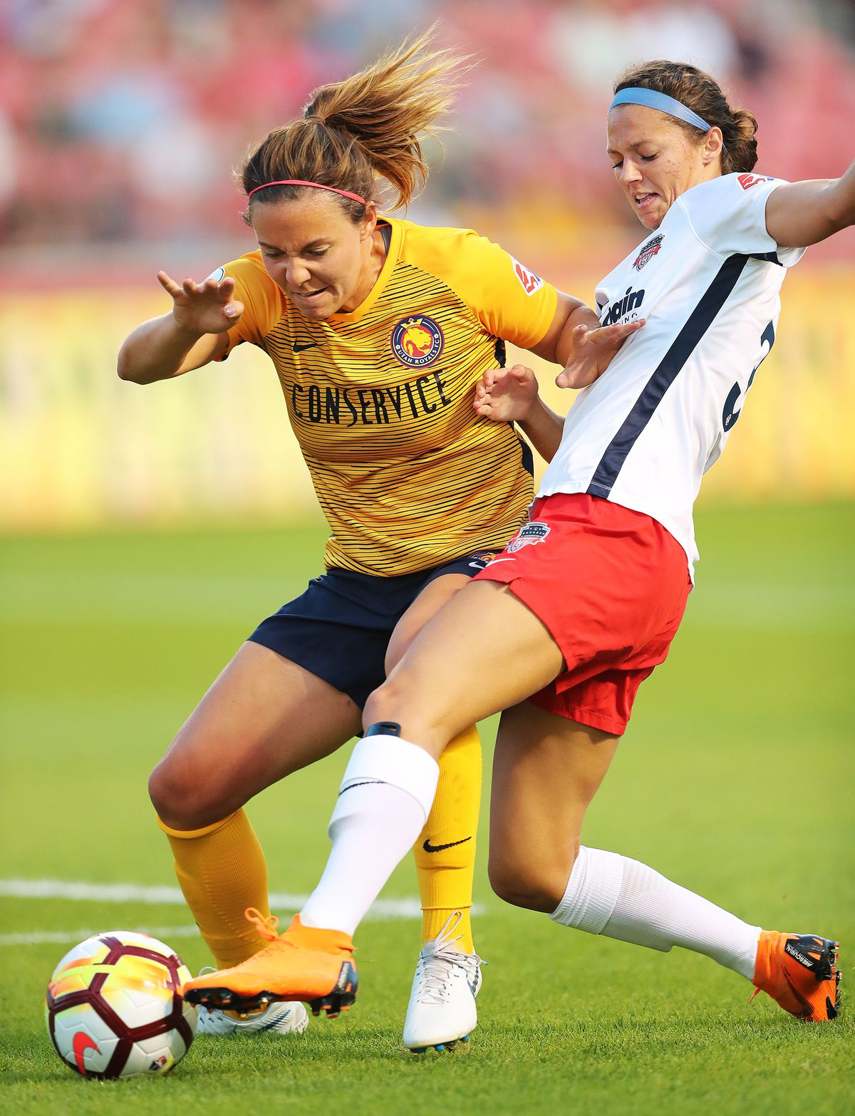 Utah Royals FC defender Rachel Corsie, left, battles Washington Spirit forward Ashley Hatch for the ball as the Utah Royals and Washington Spirit play at Rio Tinto Stadium in Sandy on Wednesday, Aug. 8, 2018.