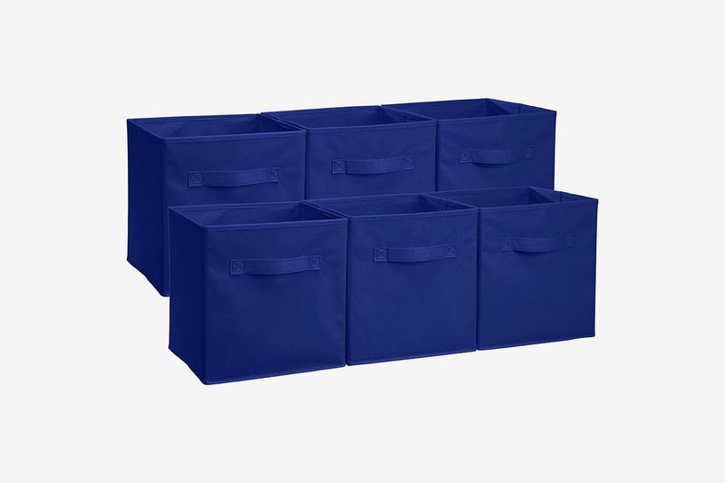 Multiple blue fabric storage boxes.