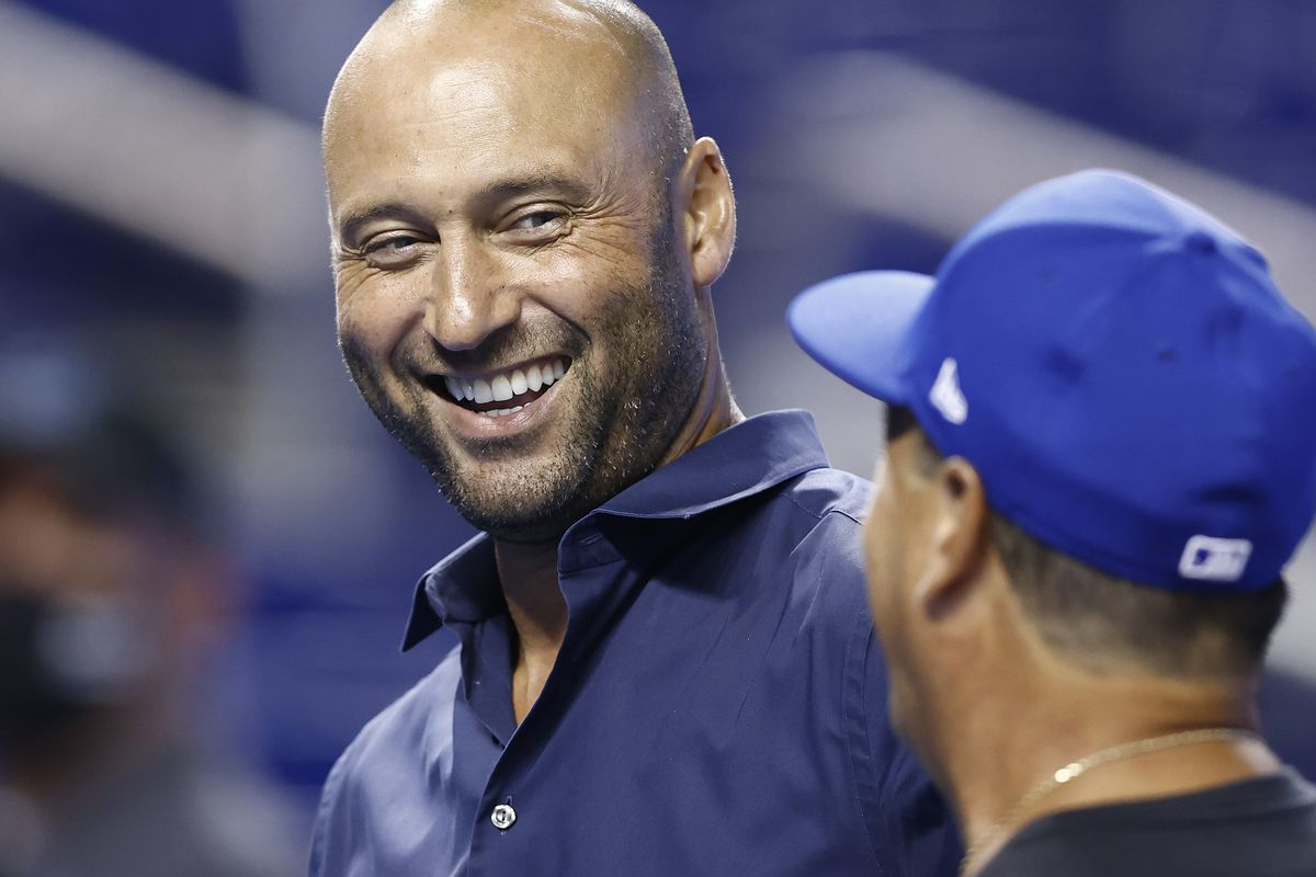 CEO Derek Jeter of the Miami Marlins talks with manager Charlie Montoyo #25 of the Toronto Blue Jays during batting practice prior to the game at loanDepot park