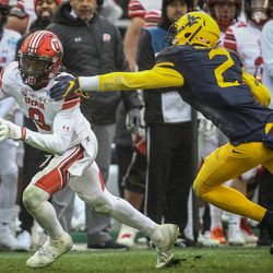Utah Utes wide receiver Darren Carrington II (9) escapes a the tackle of West Virginia Mountaineers safety Kenny Robinson (2) at the Zaxby's Heart of Dallas Bowl between the Utah Utes and the West Virginia Mountaineers in Dallas Texas on Tuesday, Dec. 26, 2017.