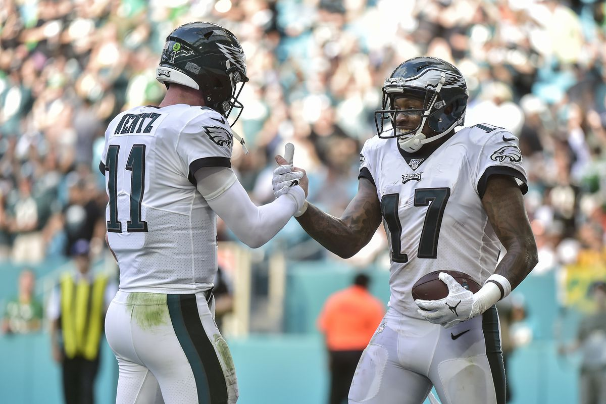 Alshon Jeffery #17 of the Philadelphia Eagles celebrates with Carson Wentz #11 after scxoring a touchdown in the third quarter against the Miami Dolphins at Hard Rock Stadium on December 01, 2019 in Miami, Florida.